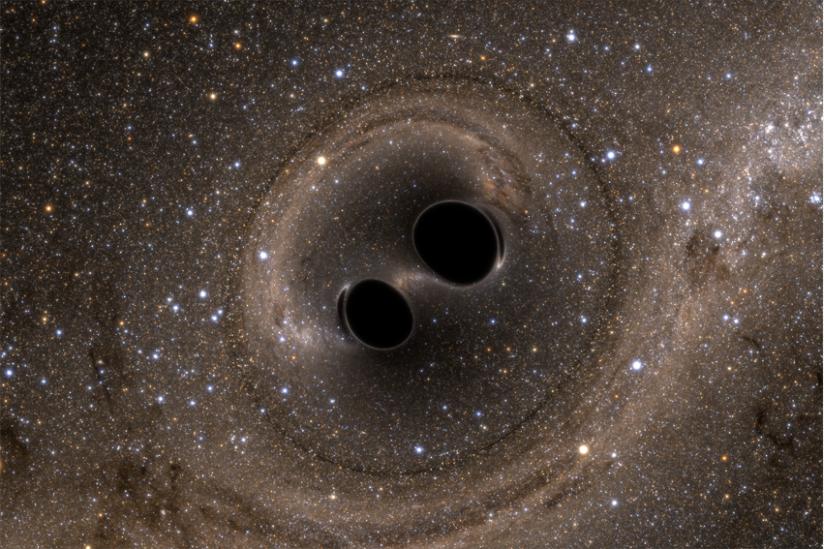 Aus zwei mach eins: Künstlerische Darstellung der Kollision zweier Schwarzer Löcher. Bei diesem Todestanz werden Gravitationswellen freigesetzt.