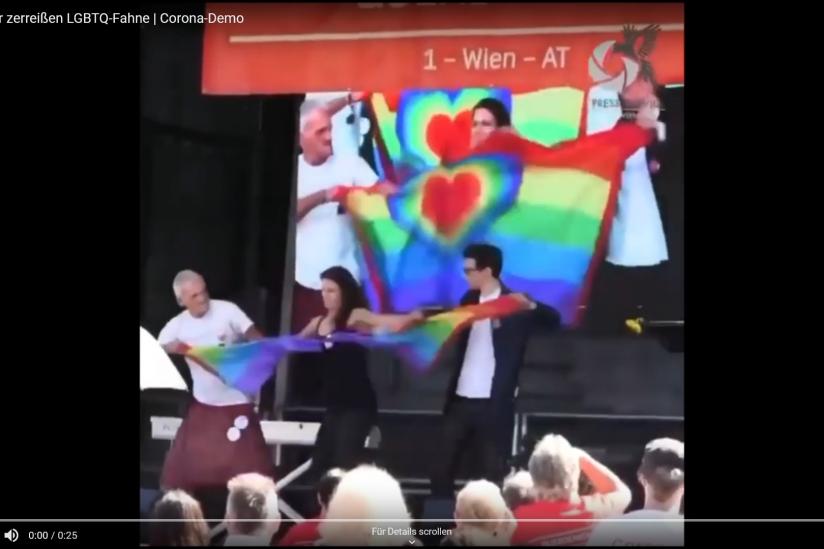 """""""Querdenker"""" Wien zerreißen Regenbogenfahne"""