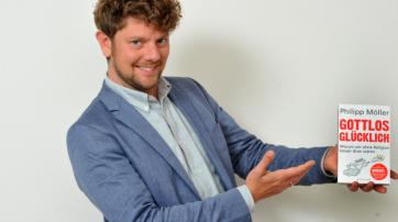 Philipp Möller präsentiert sein aktuelles Buch.
